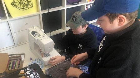 Twins Ollie and Leo KIernan have been sewing lavender bags to cheer up people in care homes.