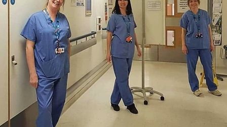 Pharmacists Di Fidler, Lucy Oakley and Sarah McMaw will now need to wear scrubs to work.