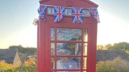 The old phone box on Mill Street in Isleham to celebrate The Queen's birthday. Picture: Walter Gunst