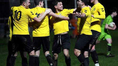 March Town players celebrate in their match with King's Lynn Town Reserves. Picture: IAN CARTER