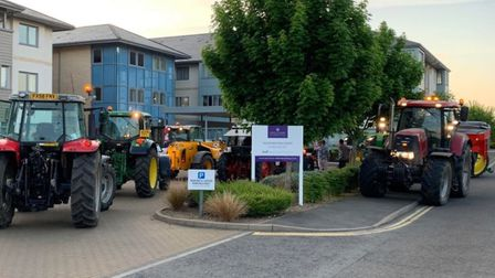 Tractor drivers encircled Doddington Court, Doddington, to recognise the care workers carrying out t