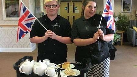 Staff and residents at Doddington Court care home celebrated 75 years of VE Day with a socially dist