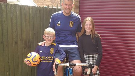 Simon Rampley (centre) will travel 366 miles on his turbo-trainer in Littleport, the distance betwee