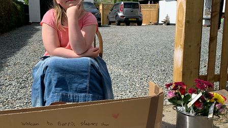 Berri White selling her flowers. Picture supplied by family