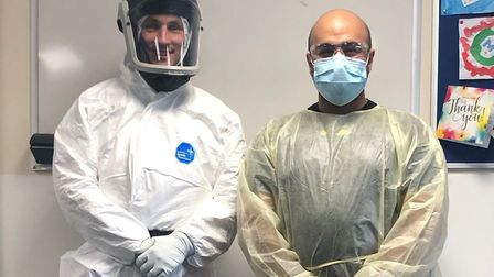 Paramedic Nigel Strange and Dr Rishi Rallan demonstrate the personal protective equipment helped by