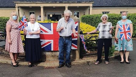 Social distancing party and sing-along to celebrate VE Day at Jubilee Court care home in March. Staf
