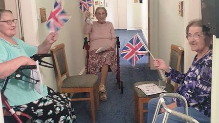 Social distancing party and sing-along to celebrate VE Day at Jubilee Court care home in March. Resi