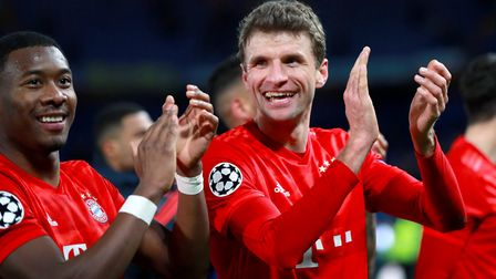 Bayern Munich's Thomas Muller (right) applauds the fans after a Champions League match at Chelsea