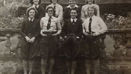 Mary Williams, then Mary Jelly (top row second left) in the Land Army in the 1940s