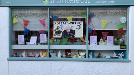 A Great Dunmow shop window which includes a picture by Katie Houghton for VE Day 2020. Picture: Alan