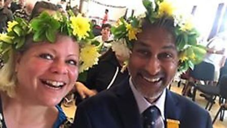 Emma Marcus and her husband Miz Sabur with flower headpieces at the event held in Foakes Hall by the