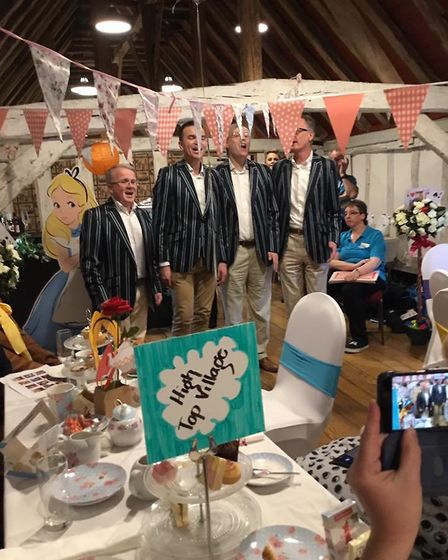A barbershop quartet perform at the Mad Hatter's Tea Party, one of the events held during Emma Marcu