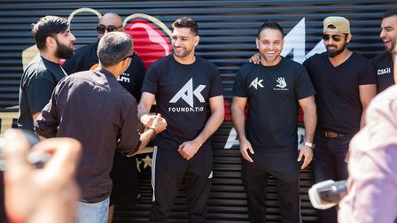 Social distancing went out of the window during a visit to Peterborough by boxer Amir Khan. He hugge
