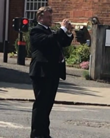Andy King from the Dunmow Town Band played The Last Post at the War Memorial. Picture: Dunmow and Di