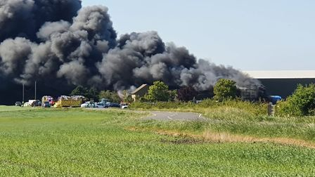 Today's fire at Corkers Crisps at Pymoor near Ely. Picture; CATHERINE ADAMS