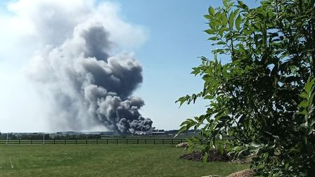 From a distance, the scene a few minutes ago looking towards Pymoor where a major fire is being tack