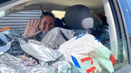 Ely Hero Fleur Patten drove to Shoe Aid UK's headquarters in Nottingham to deliver 200 pairs of shoe
