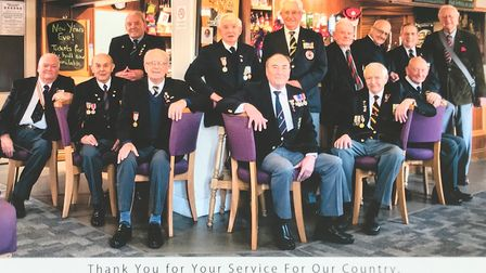 Derek (back, third from left) pictured with members from the Ely branch of the Korea Veterans Associ