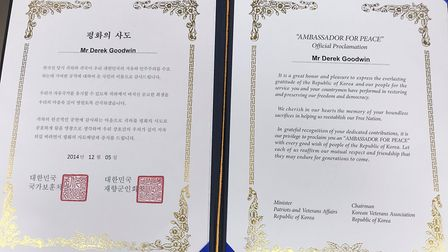 An official proclamation that Derek previously received, written in both English and Korean. Picture