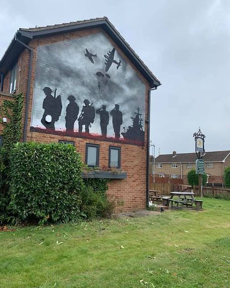 This poignant mural has been created on the side of the Straw Bear public house in Whittlesey. Custo
