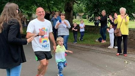 Crowds of cheering people armed with balloons and banners greeted Doddington man James Langley as he