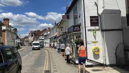 People could be seen queueing on Great Dunmow's High Street. Photo: Andra Maciuca.