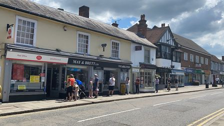 People queueing outside the post office in Great Dunmow. Photo: Andra Maciuca.