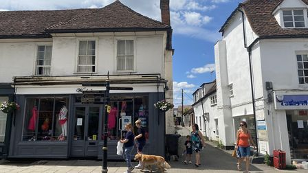 Adults, children and dogs have all been social distancing as more shops opened in Great Dunmow. Phot