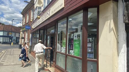 People could be seen coming in and out of a chemist in Great Dunmow. Photo: Andra Maciuca.