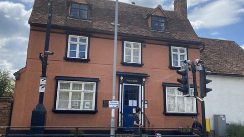 Two men could be seen planting flowers outside Foakes House, Great Dunmow Town Council. Photo: Andra