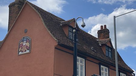 """A coat of arms reading """"May Dunmow prosper"""" on Foakes House, Great Dunmow Town Council. Photo: Andra"""