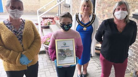 Deborah Slator, Emmilee Wardley and Di Coulson of the Helping Whittlesey group with Cllr Julie Windl