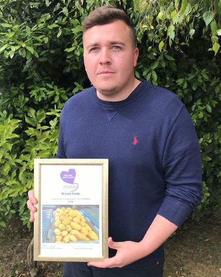 Joshua Lawton from McCain Foods with his certificate. Picture: ROBERT WINDLE