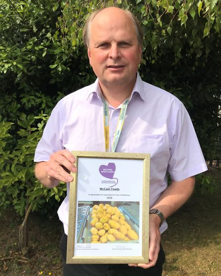 Geoff Dennis from McCain Foods with his certificates. Picture: ROBERT WINDLE