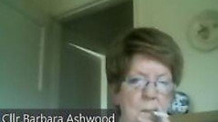 Cllr Barbara Ashwood has apologised after being caught smoking during a virtual meeting of the commu