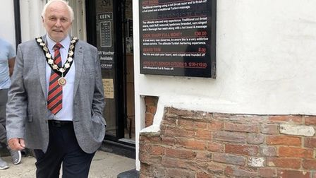 Great Dunmow mayor Mike Coleman outside Look Sharp barbers on High Street, Great Dunmow. Picture: Ra