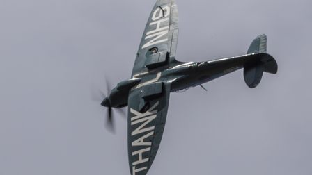 High above Hinchingbrooke Hospital. The special Thank You NHS Duxford Spitfire flying over parts of