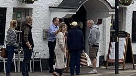 People patiently queued outside Ye Olde Griffin Hotel on Saturday (July 4) as it re-opened for the f