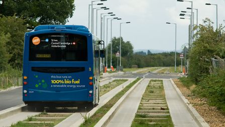 Stagecoach guided bus moves through Longstanton. The guided busway has been a success but legal issu