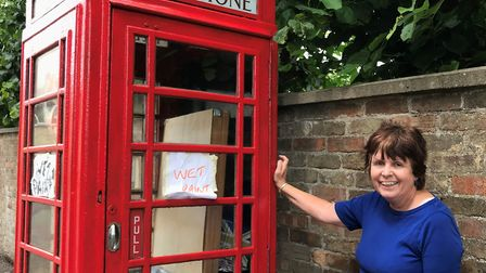 Julie has also been working on the last remaining telephone box in Chatteris. Picture: DAN MASON