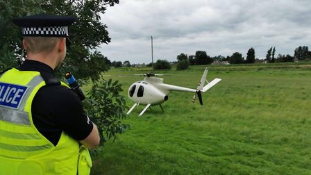 The white helicopter landed in a field next to the A47 at Guyhirn to deliver a new wheel to a strand