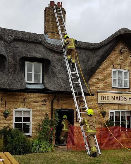Firefighters were called to tackle a chimney fire at The Maid's Head in Wicken on Saturday night. Pi