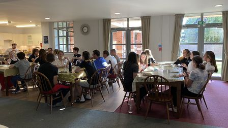 Pupils enjoy a family meal as a boarding household at Felsted School in North Essex. Picture: Felste