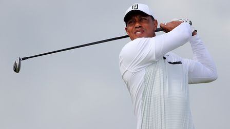 Tiger Woods tees off at The Open Championship at Royal Portrush Golf Club in 2019