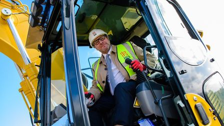 Mayor James Palmer behind the digger controls in Fordham where the first £100K Homes have started co