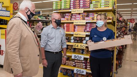 Great Dunmow mayor Mike Coleman, Tesco Dunmow store manager Paul Smith and colleague Caroline Bone.P