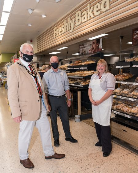Great Dunmow mayor Mike Coleman, Tesco Dunmow store manager Paul Smith and colleague July O'Toole.Pi