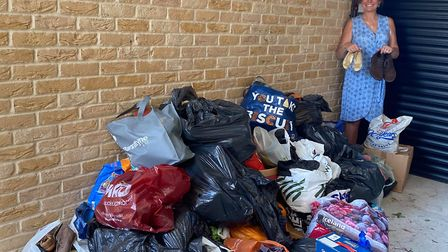 Ely community champion Fleur Patten has filled her garage with donated shoes for Shoe Aid. She is no