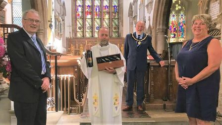 The team rector of Whittlesey, Pondersbridge and Coates, Reverend Nigel Whitehouse (centre) is taki