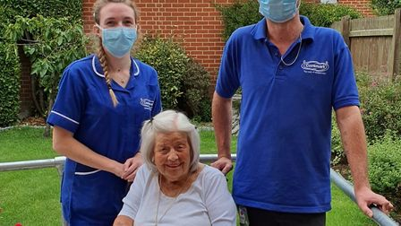 Abigail Byrne and Arron Griggs with Ivy Asker, a Caremark client since 2013. Picture: CAREMARK